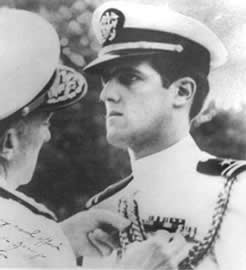 Kerry, seen in this 1960s photo, receives a military decoration during the Vietnam War