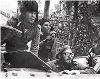 Castro, lower right, watches from a tank near Playa Giron during the Bay of Pigs invasion in 1961