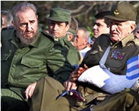 Castro, left, and Vice President Jose Ramon Fernandez attend the anniversary celebration of Cuba's 1961 Bay of Pigs victory